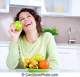 afslanken, concept., lachen, jonge vrouw , eet, vers fruit