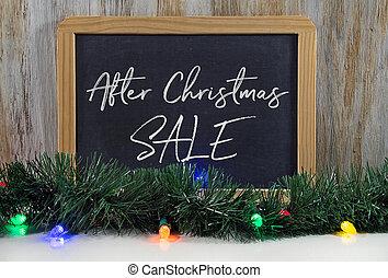 Christmas sale sign on black chalkboard