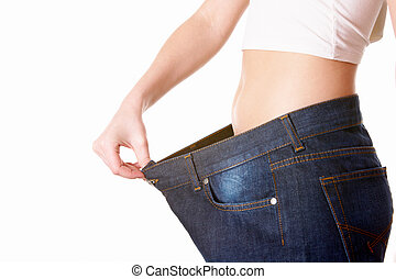 After diet - Close-up of female in good shape with jeans of...