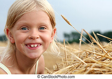After harvest - Little girl on the stubble