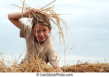 After harvest - Young girl on the stubble