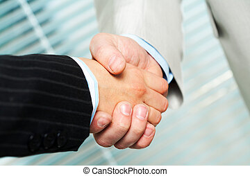 After negotiations - Photo of handshake of business partners...