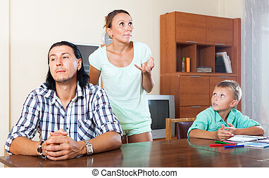 After quarrel - Man with wife and teenage son after quarrel...