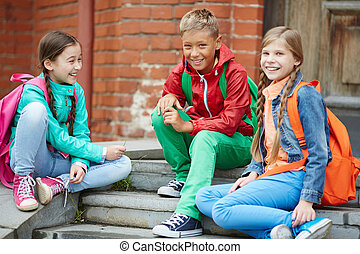 After school - Happy schoolkids in casual enjoying time...