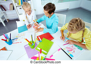 After school - Trio of friends enjoying drawing in an...