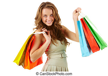 After shopping - A girl with paper bags looking at camera...
