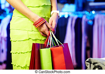 After shopping - Image of shopaholic hands with three...
