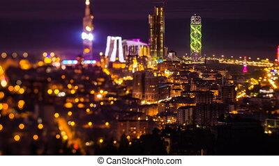 After sunset, night timelapse Batumi cityscape pan up - 4K...