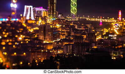 After sunset, night timelapse Batumi cityscape pan up