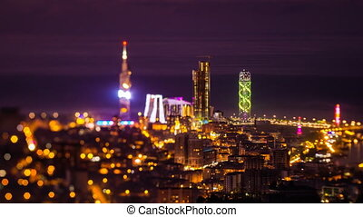 After sunset, night timelapse Batumi cityscape zoom in
