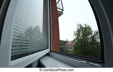 window covered with raindrops