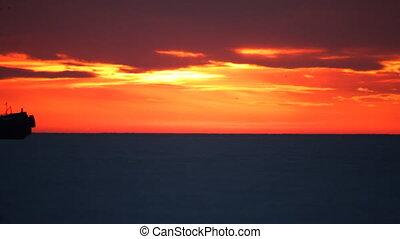 After the sunset. - Sea sunset. Tugboat. Nautical derrick.