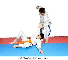 After throwing athlete in karategi