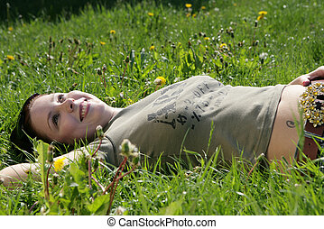 after work - young girl relaxing in the grass