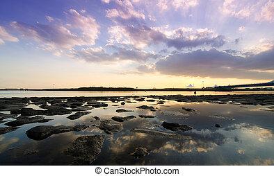 Afterdark. View of a tropical lagoon at dusk, Kasairinkai...