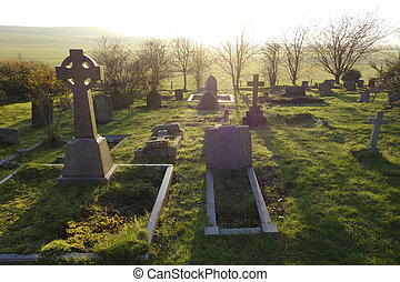 Afterlife - Heavenly light shining upon a old graveyard in ...