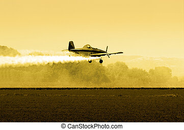 Afternoon Crop Duster - Crop Duster Flying Low over Fields...