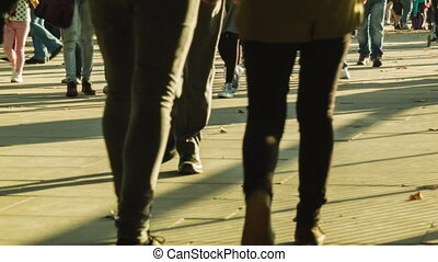 Afternoon crowd with long shadows - Anonym crowd walking at...