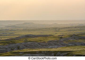Afternoon Light Fades Over Badlands Formations