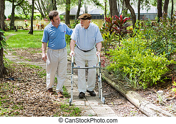 Afternoon Stroll - Elderly father and adult son out for a ...