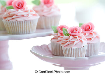 Afternoon tea - Cupcakes decorated with pink sugar roses