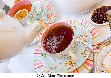 Having afternoon tea on the verandah