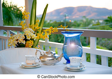 Afternoon tea on verandah looking out over the ranges