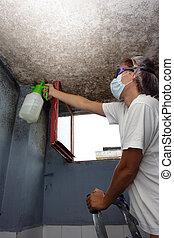 woman sprayed with detergent against mildew