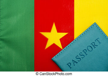 Against the background of the flag of Cameroon is a passport.