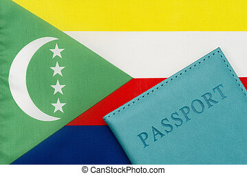 Against the background of the flag of Comoros is a passport.
