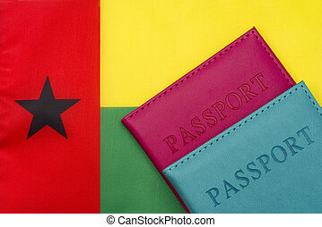Against the background of the flag of Guinea-Bissau is a passport.
