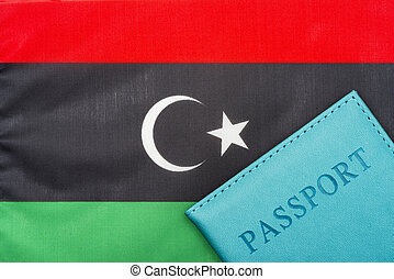 Against the background of the flag of Libya is a passport.
