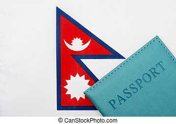 Against the background of the flag of Nepal is a passport.