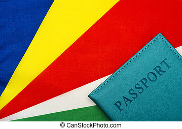 Against the background of the flag of Seychelles is a passport.