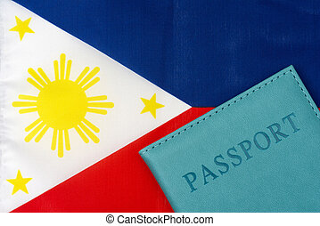 Against the background of the flag of the Philippines is a passport.
