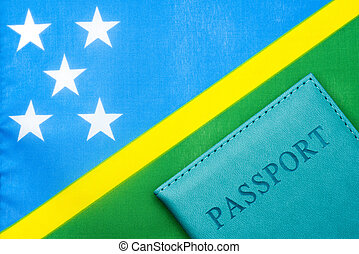 Against the background of the flag of the Solomon Islands is a passport.