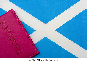 Against the flag of Scotland is a passport.