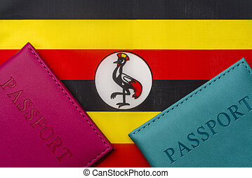 Against the flag of Uganda is a passport.