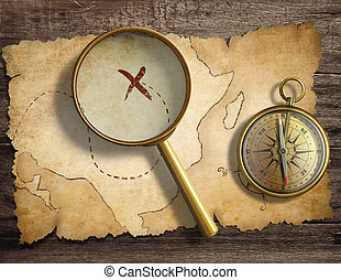 aged antique nautical compass and magnifying glass on table...