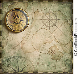 aged brass antique nautical compass and old treasure map