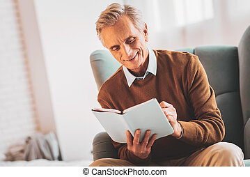 Aged businessman checking his weekly planner - Weekly ...
