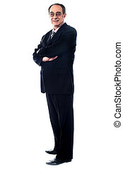 Aged company manager posing with folded arms