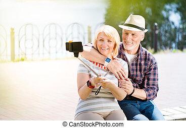 Aged couple enjoying each other