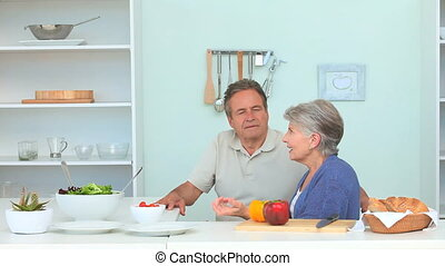 Aged couple preparing the dinner