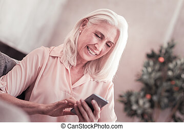 Aged cute lady messaging and smiling. - Adore messaging. ...