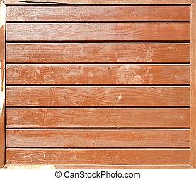 Aged dark brown cracked wooden planks closeup