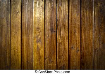 Aged dark brown wooden planks closeup