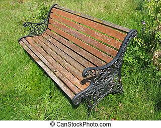 Aged Garden Bench - Aged bench in a savaged garden.