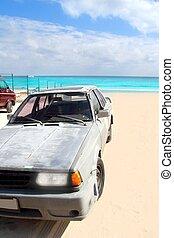 aged grunge car in Mexico Caribbean beach