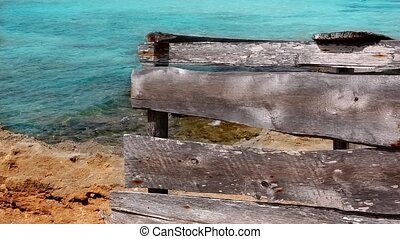 Aged grunge wood on turquoise sea - Aged grunge gray wood on...